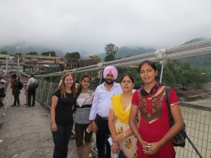 Melinda with the family on the bridge over the Ganges.